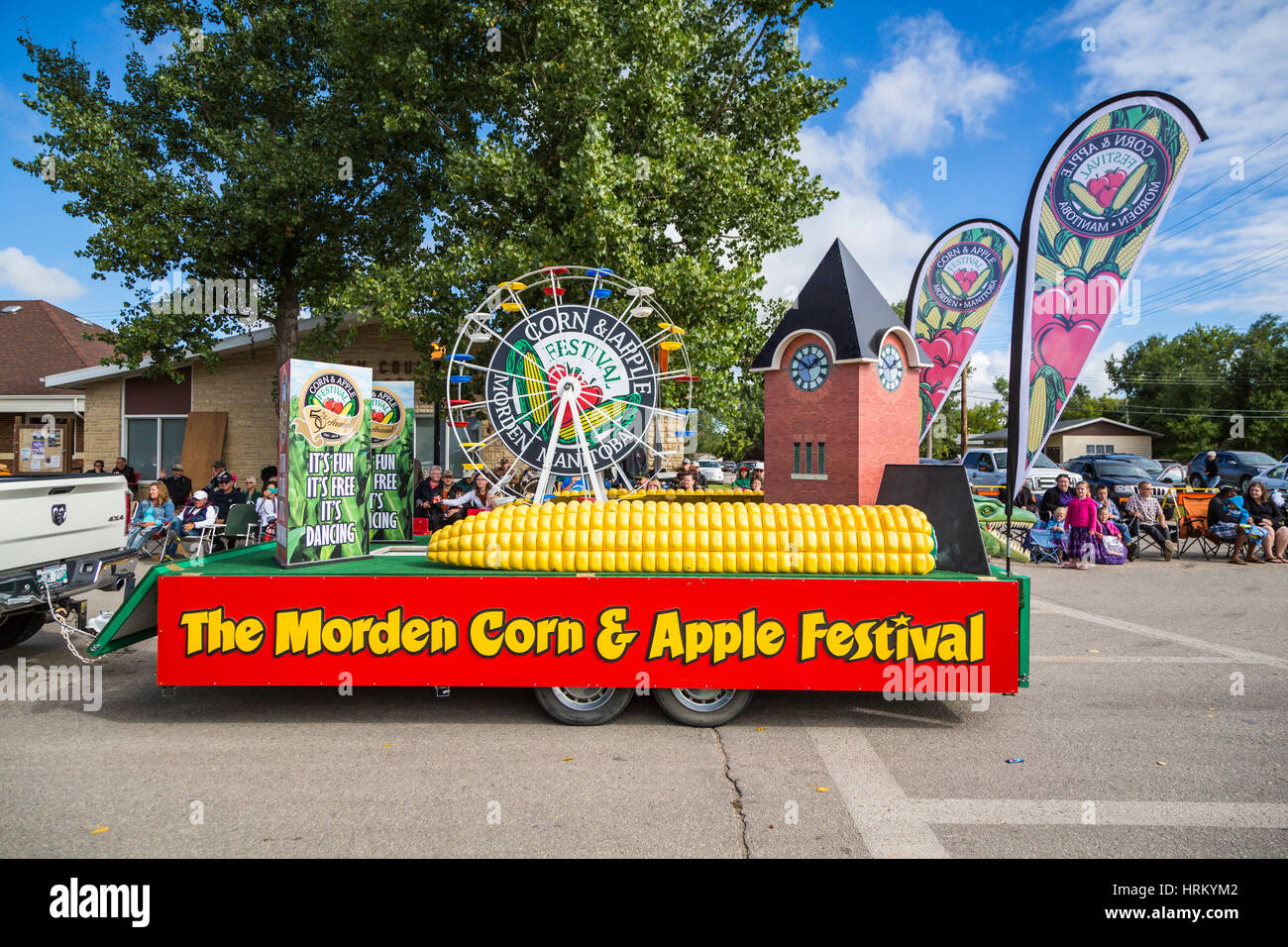 The Morden Corn and Apple Festival float the 2016 Plum Fest street parade in Plum Coulee, Manitoba, Canada. - Stock Image