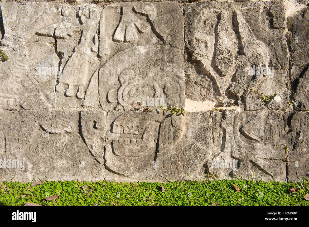 Bas relief with skull carved on stone at Chichen Itza Yucatan Mexico - Stock Image
