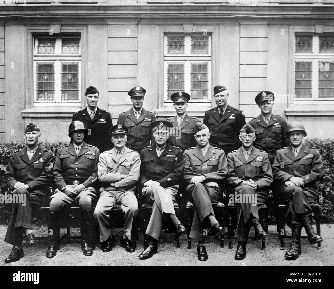 DWIGHT D. EISENHOWER  in 1945 with some of his key of officers. Seated from left: William Simpson, George Patton, - Stock Image