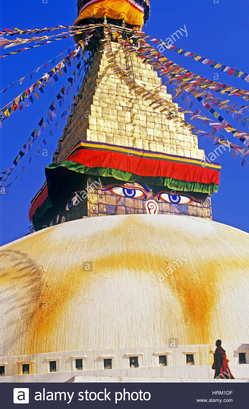 Buddhist monk walking around Boudhanath Temple, Boudhanath, Katmandu, Nepal, Asia - Stock Image