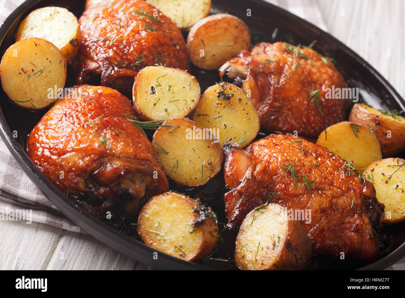 American food maple chicken thighs and baby potatoes close up on a american food maple chicken thighs and baby potatoes close up on a plate horizontal forumfinder Image collections