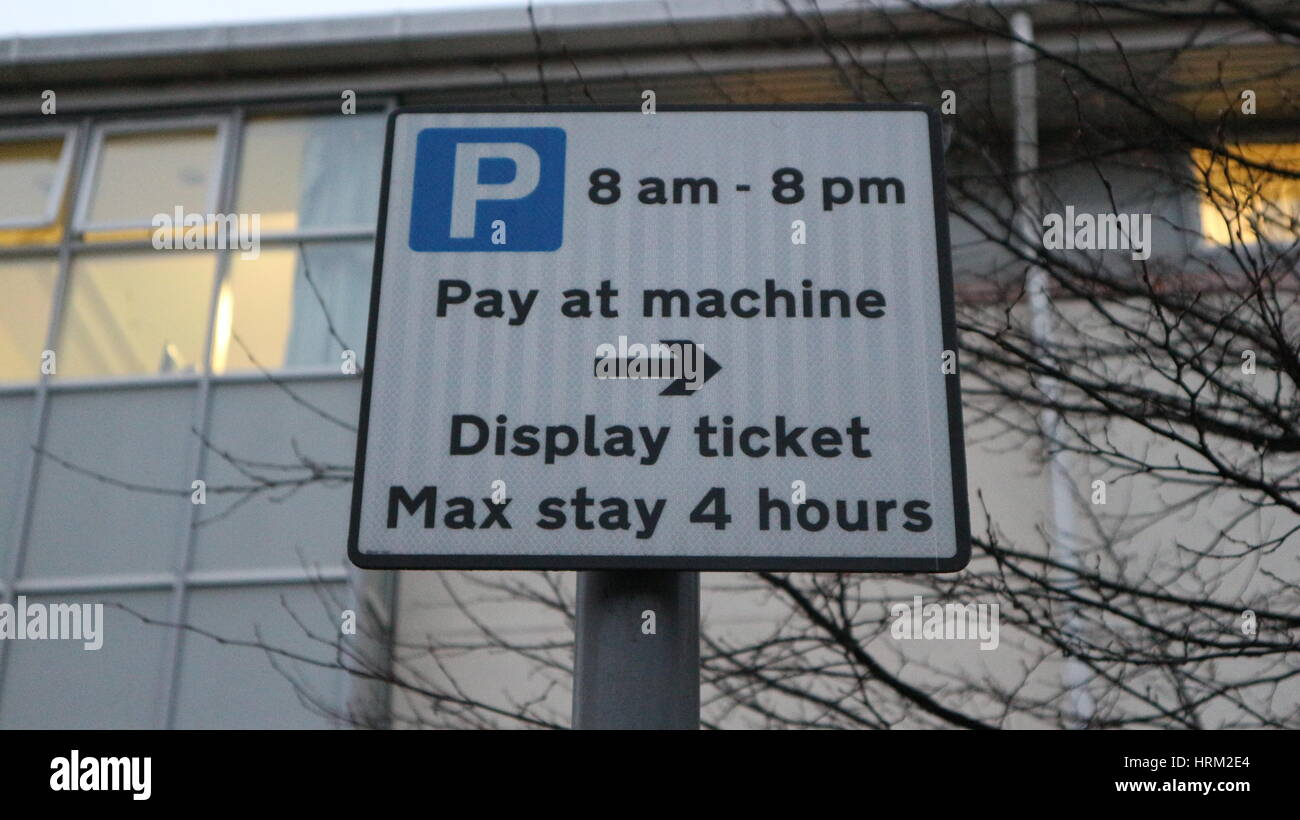 Pay and display on street parking signpost,close up,UK - Stock Image