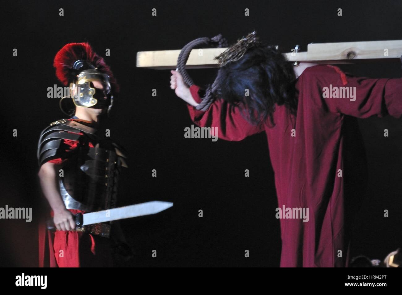 Mystery of the Passion - Actor reenacting Christ carrying the Cross to his place of execution. Outdoor spectacle, - Stock Image