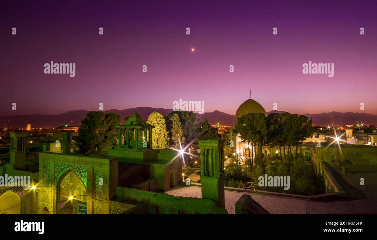 Panorama view over the roof's of Kashan by night with moon - Stock Image