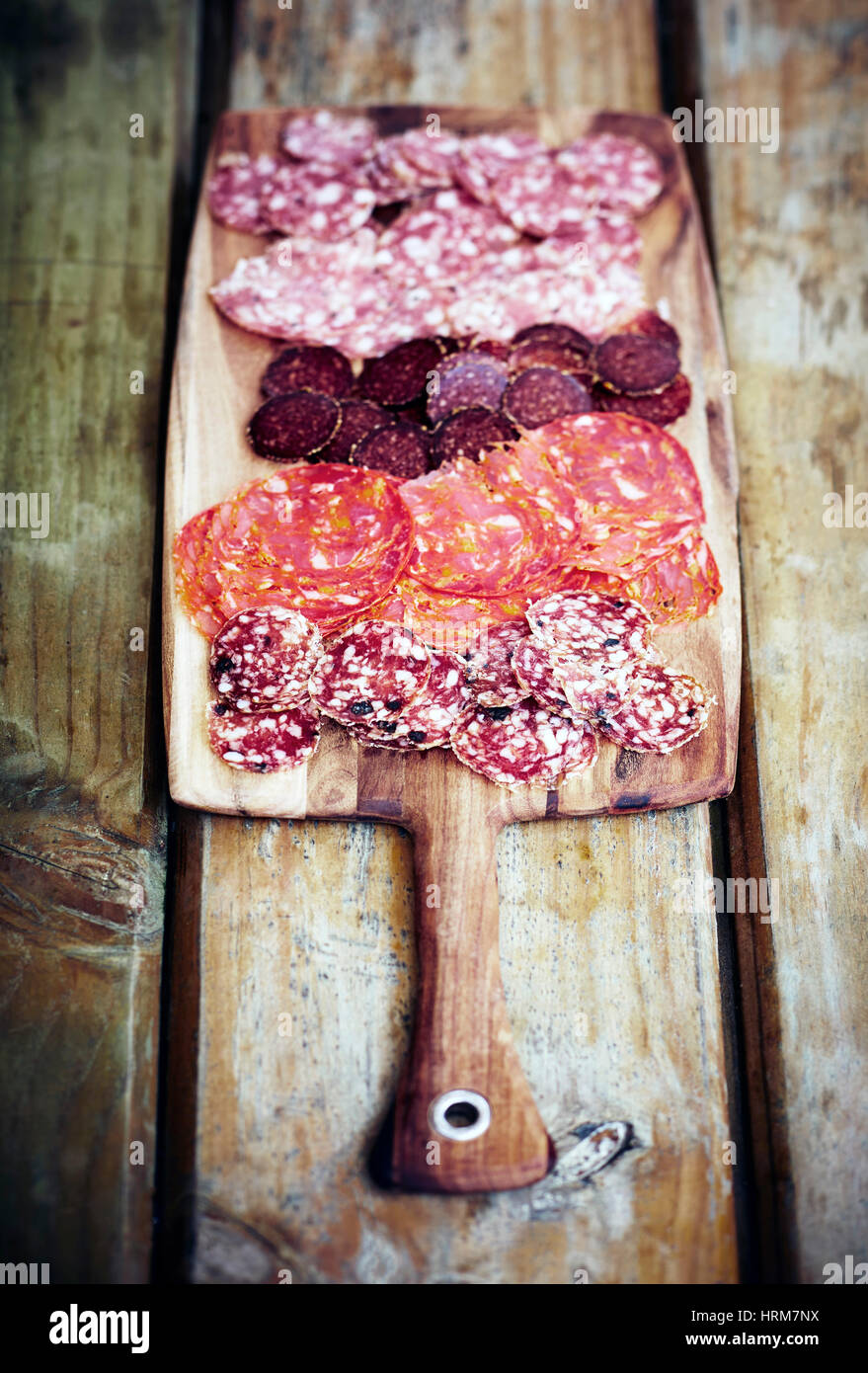 Antipasti of different cured meats and salami - Stock Image