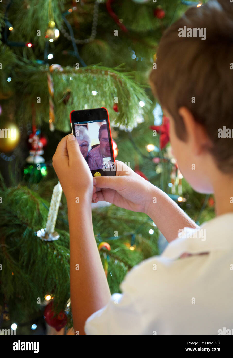 Boy video conference with  grandparents on christmas day - Stock Image