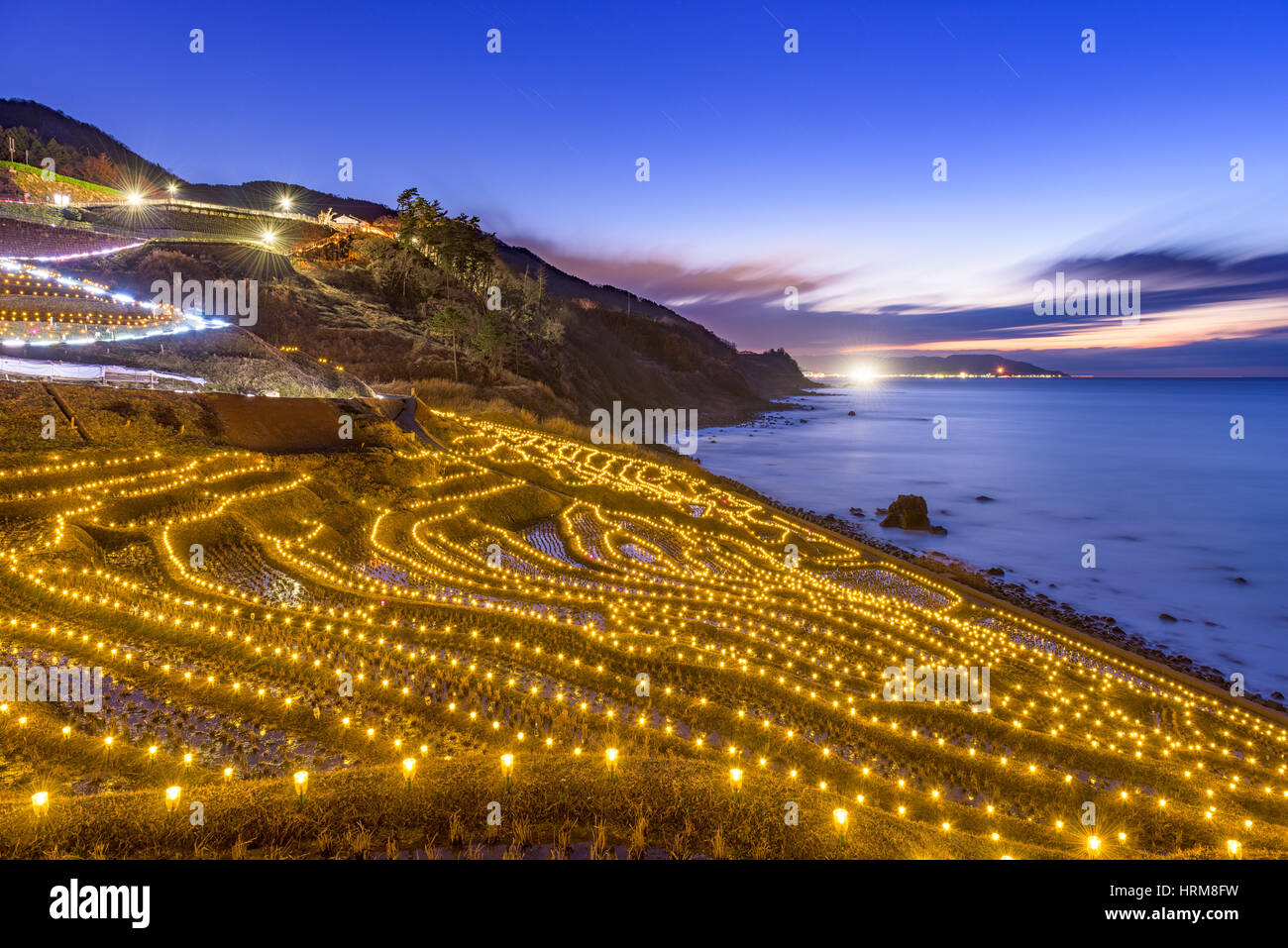 Wajima, Japan at Shiroyone Senmaida rice terraces during a winter light up. - Stock Image