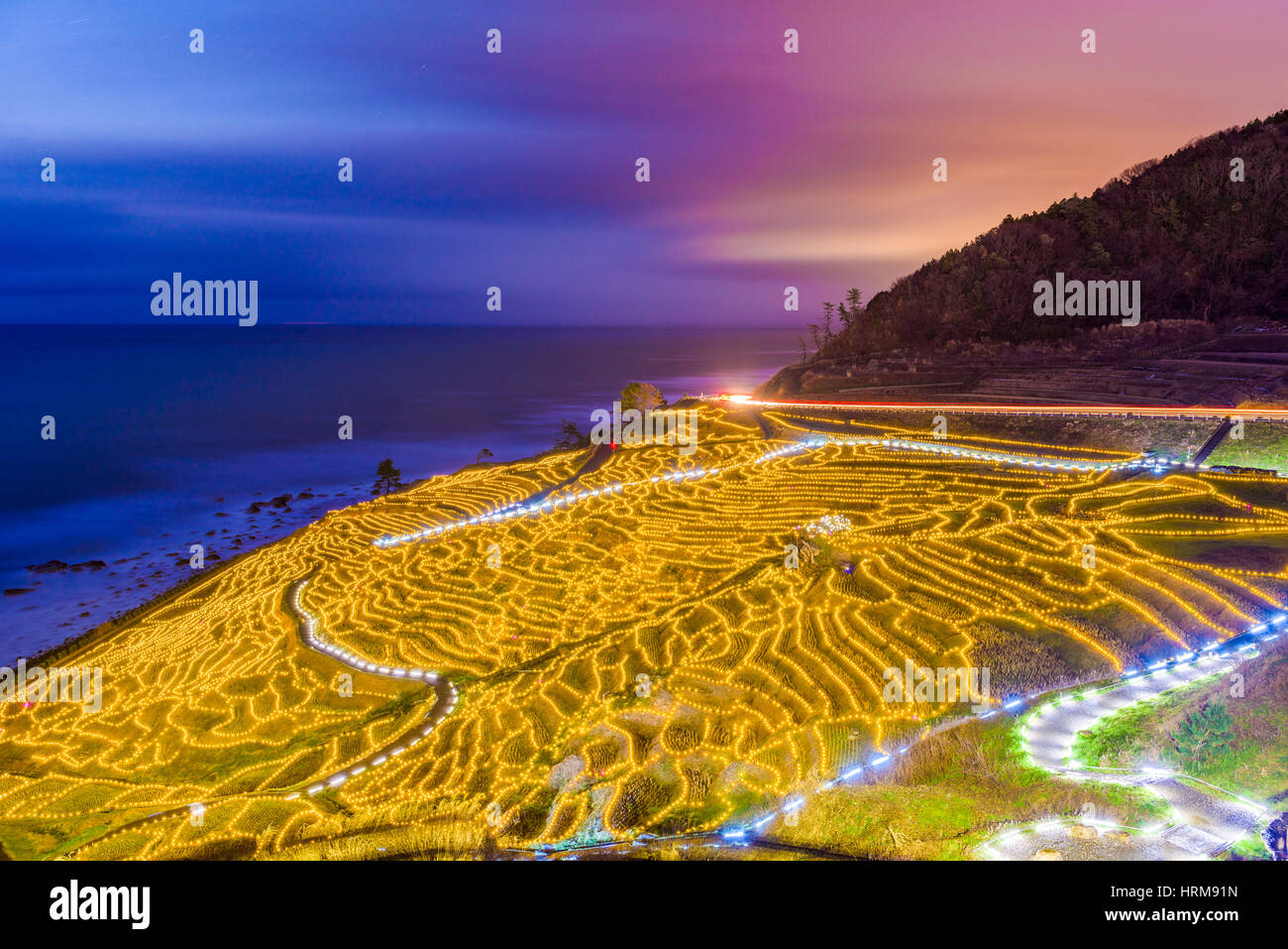 Wajima, Japan at Shiroyone Senmaida rice terraces at night. - Stock Image