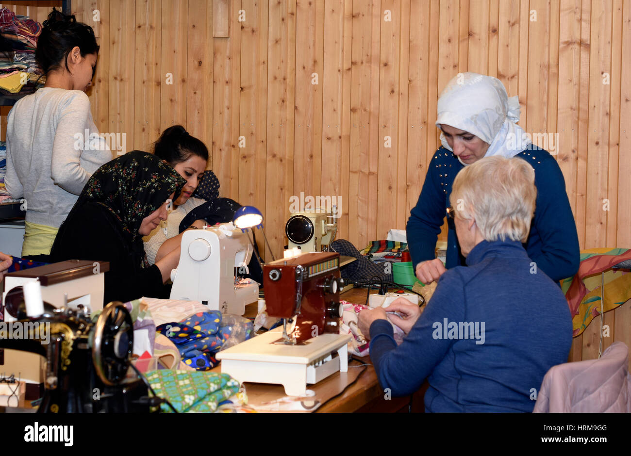 Mellansel,Sweden - Februari 02,2017:Refugees and Retired women together with handwork as a part of integration to - Stock Image