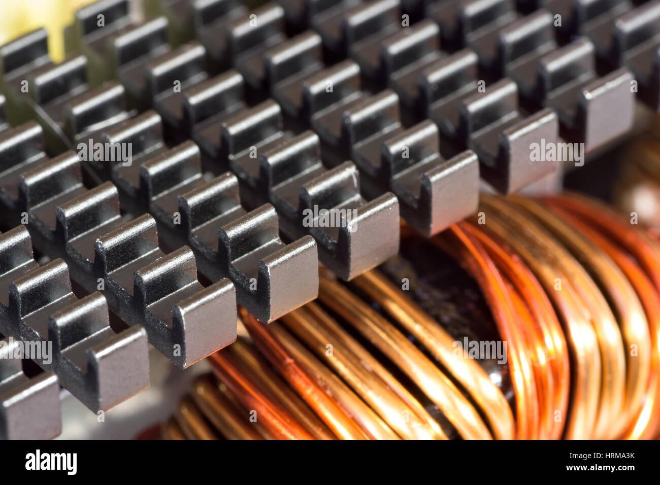 Radiator and inductance coil close-up - Stock Image