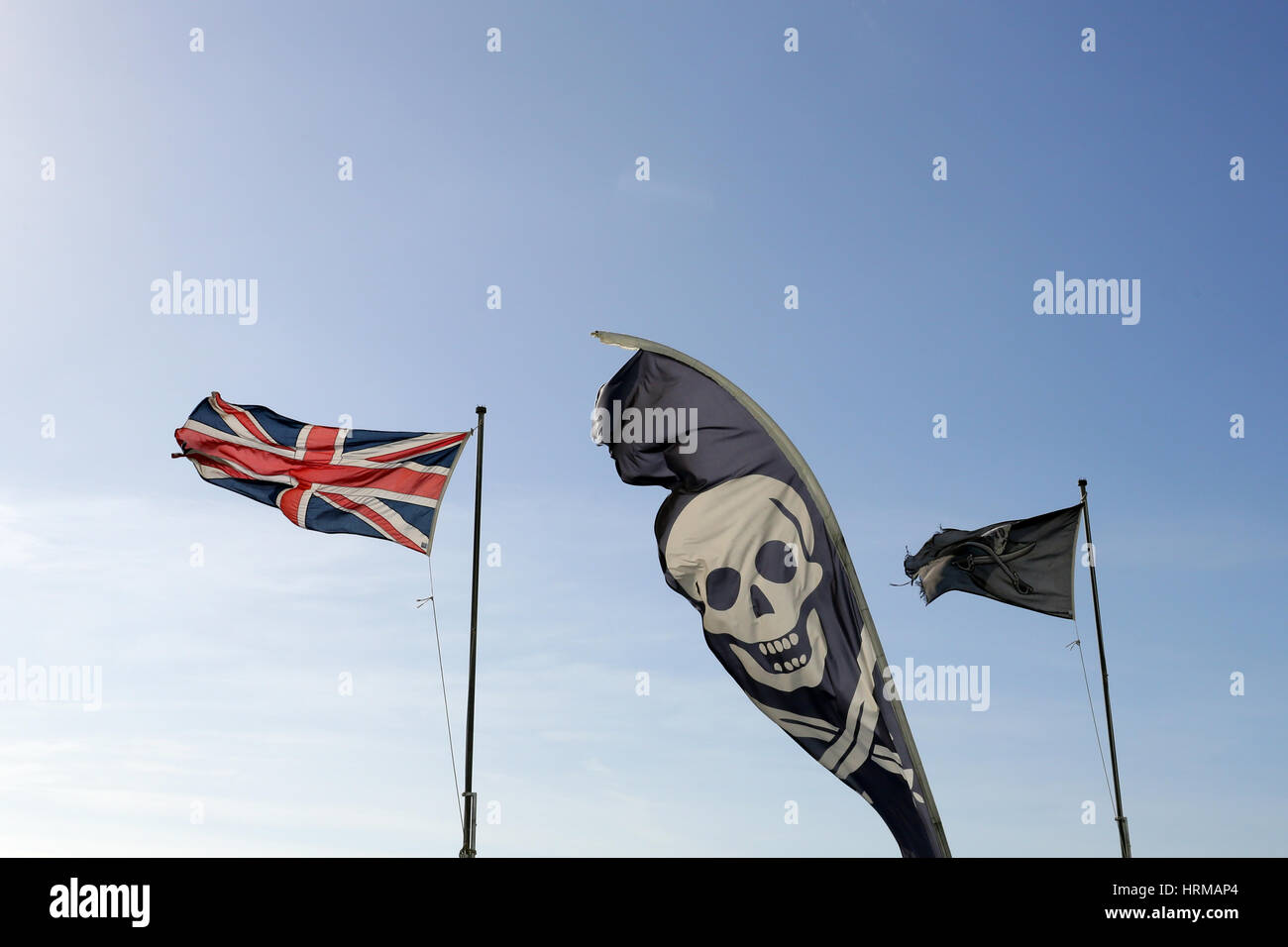 Jolly Roger Skull and Crossbone and Union Flag - Stock Image