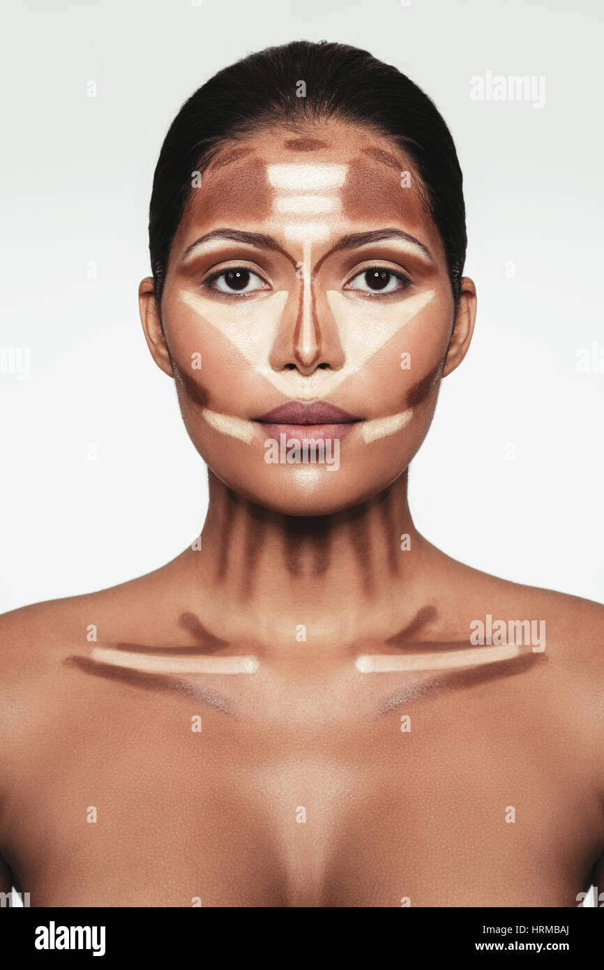Close up portrait of contour and highlight makeup on female model. Professional contouring face makeup technique. Stock Photo