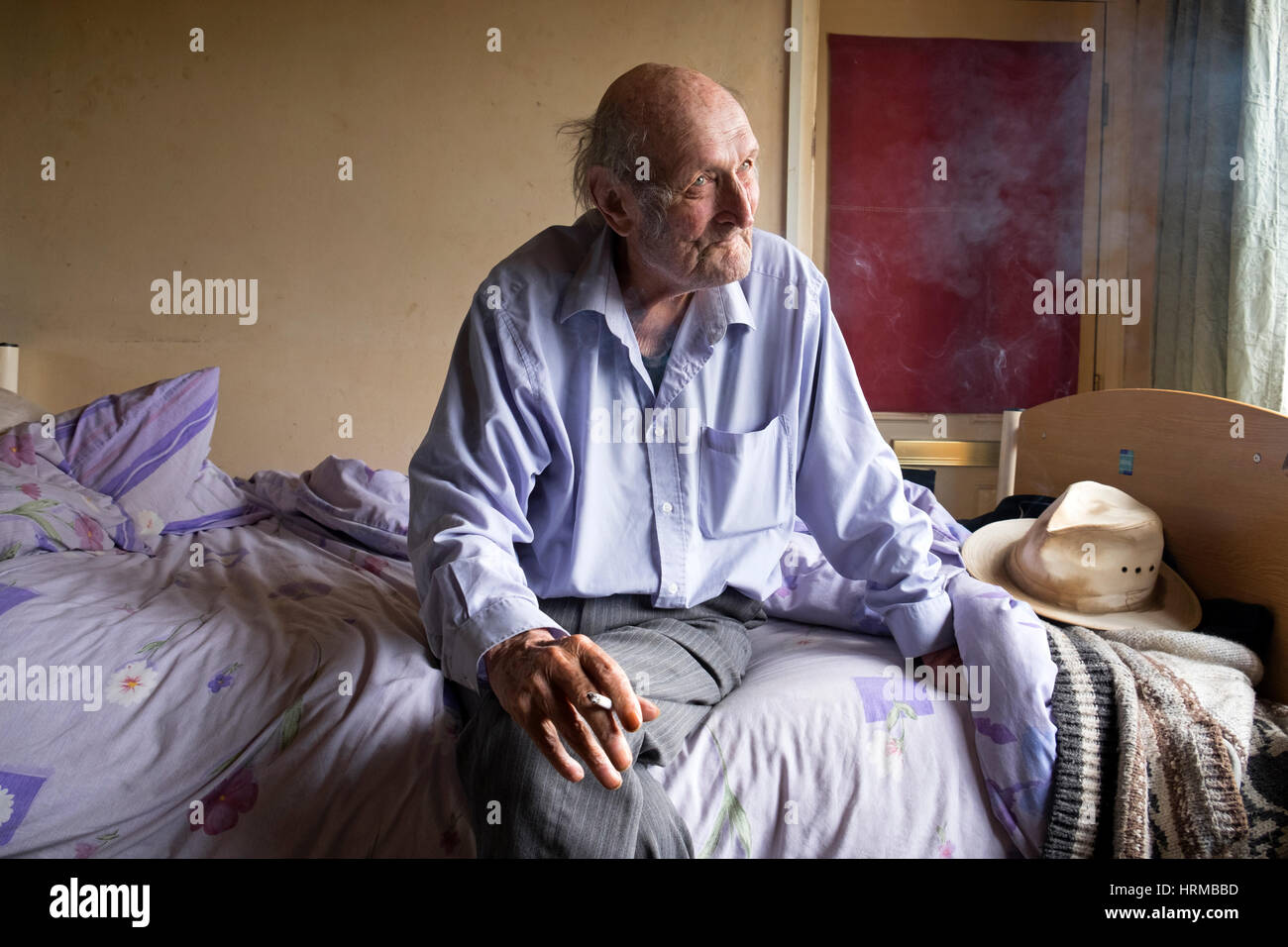 Impoverished bedridden man - Stock Image