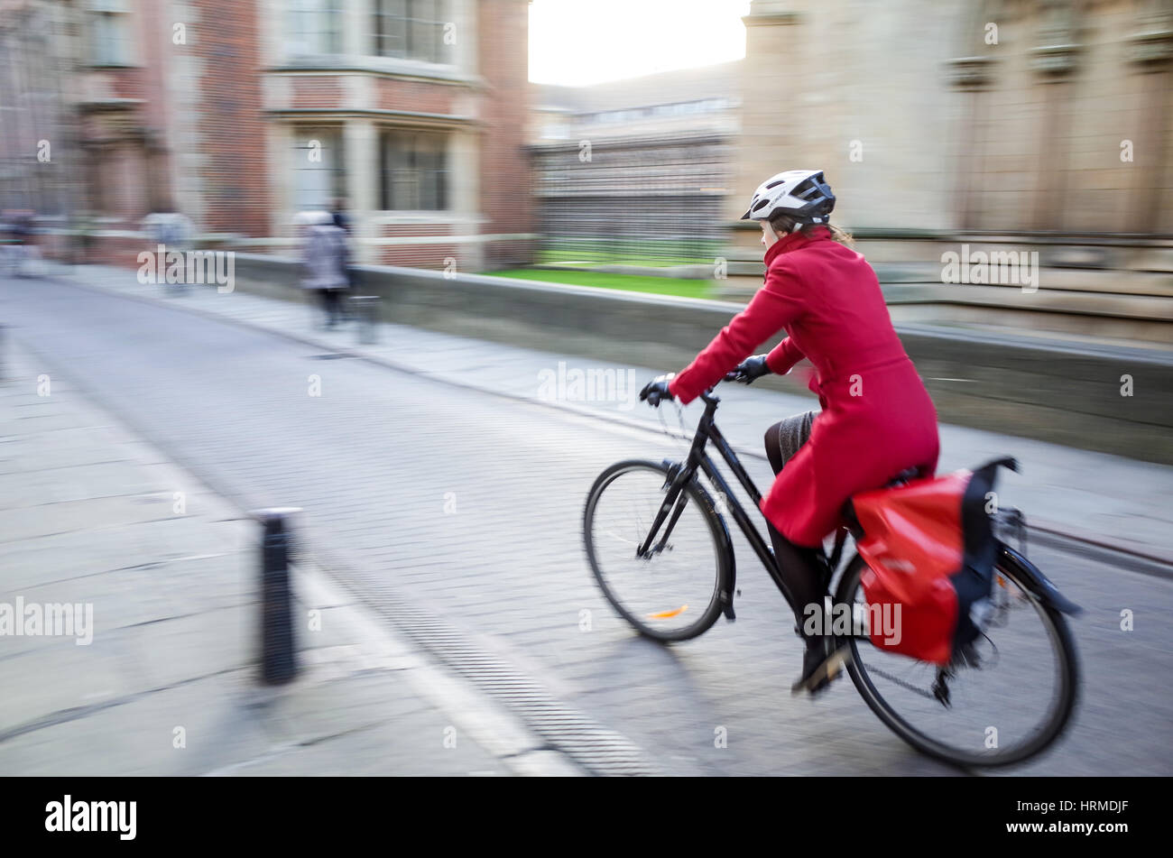 Motion Blur - Commuters cycle through central Cambridge - Stock Image