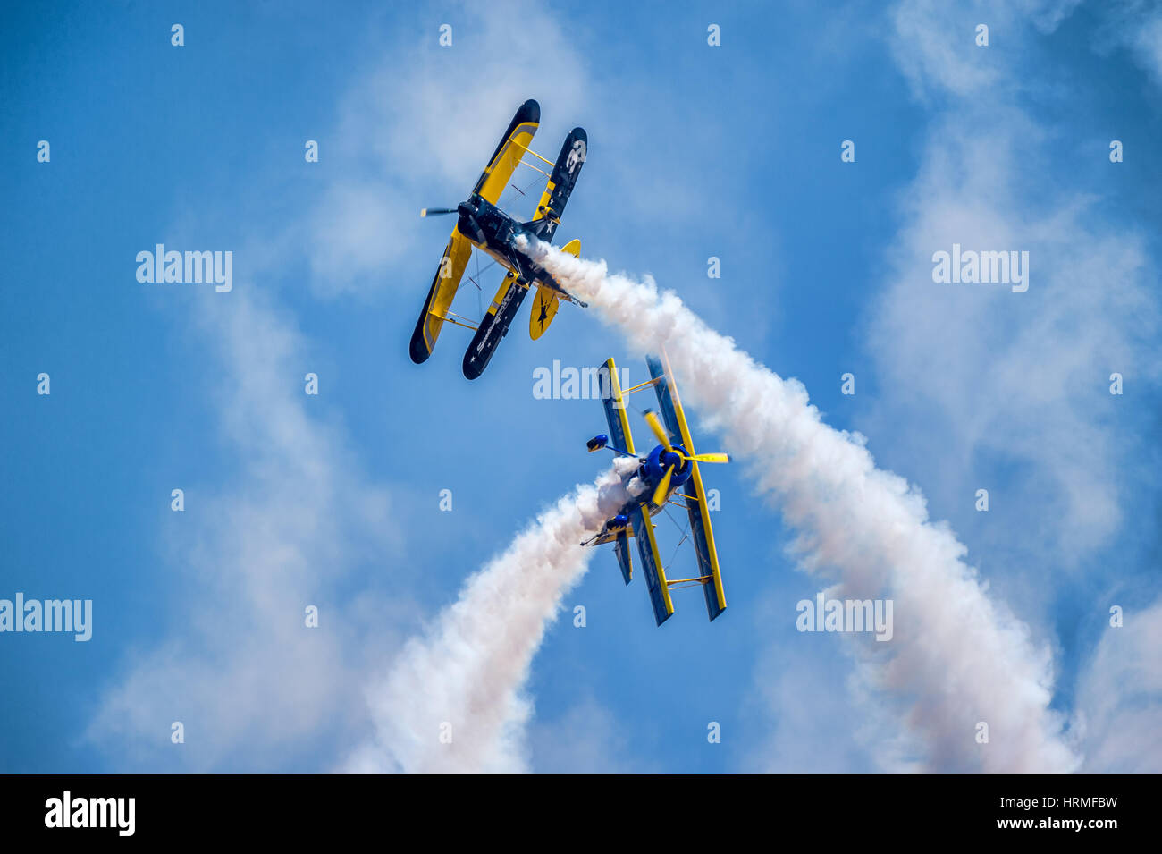Skycat Wingwalkers' from the Scandinavian Airshow aerobatic team perform at the opening ceremony of Aero India - Stock Image