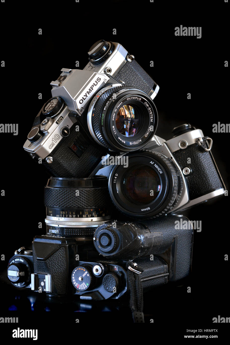 Pile of old retro film cameras - Nikon, Olympus - Stock Image