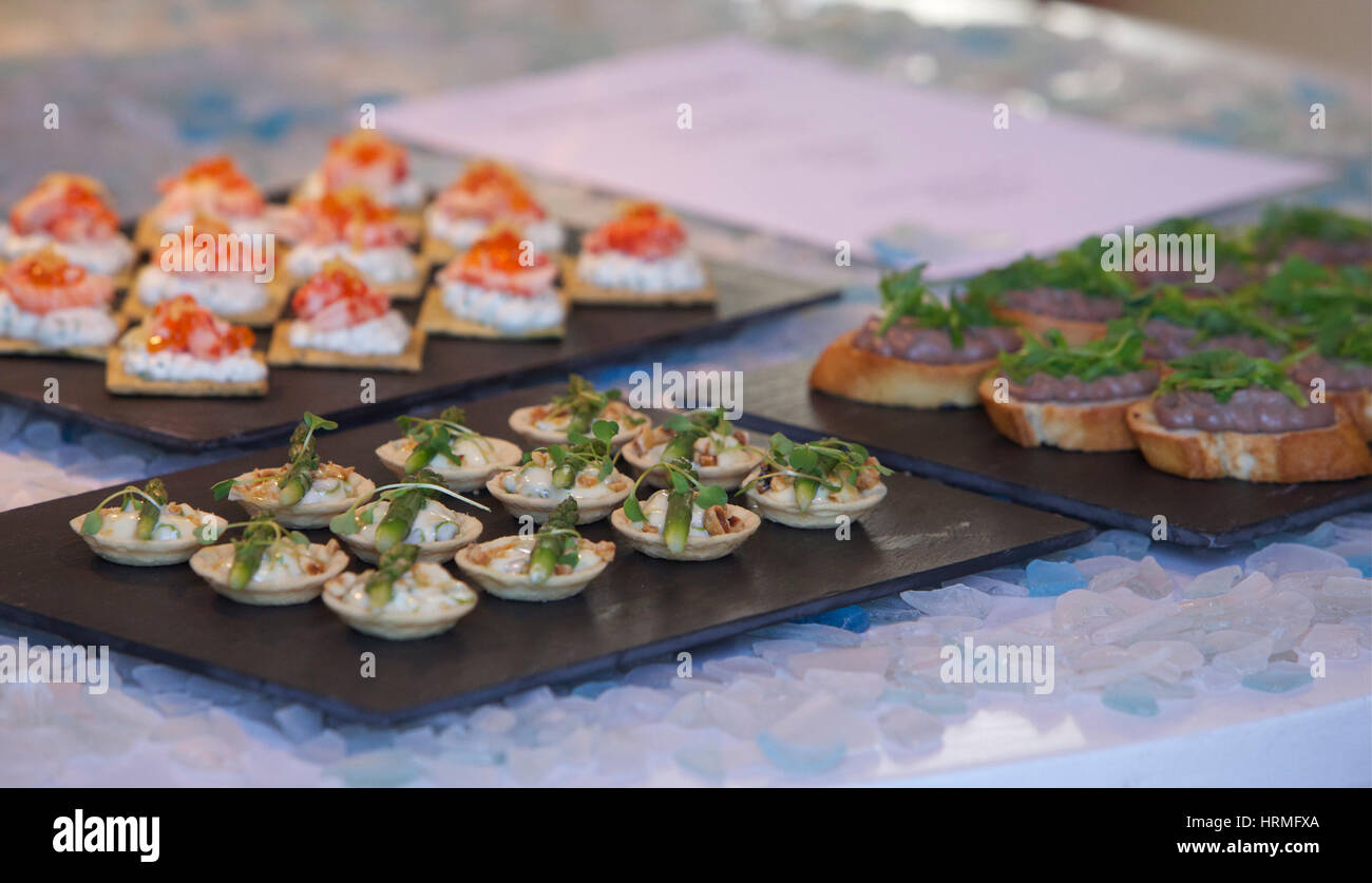 table of canapés at a dinner party - Stock Image