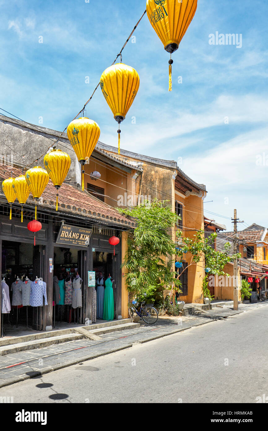 Garland of yellow lanterns hanging across the street. Hoi An Ancient Town, Quang Nam Province, Vietnam. - Stock Image