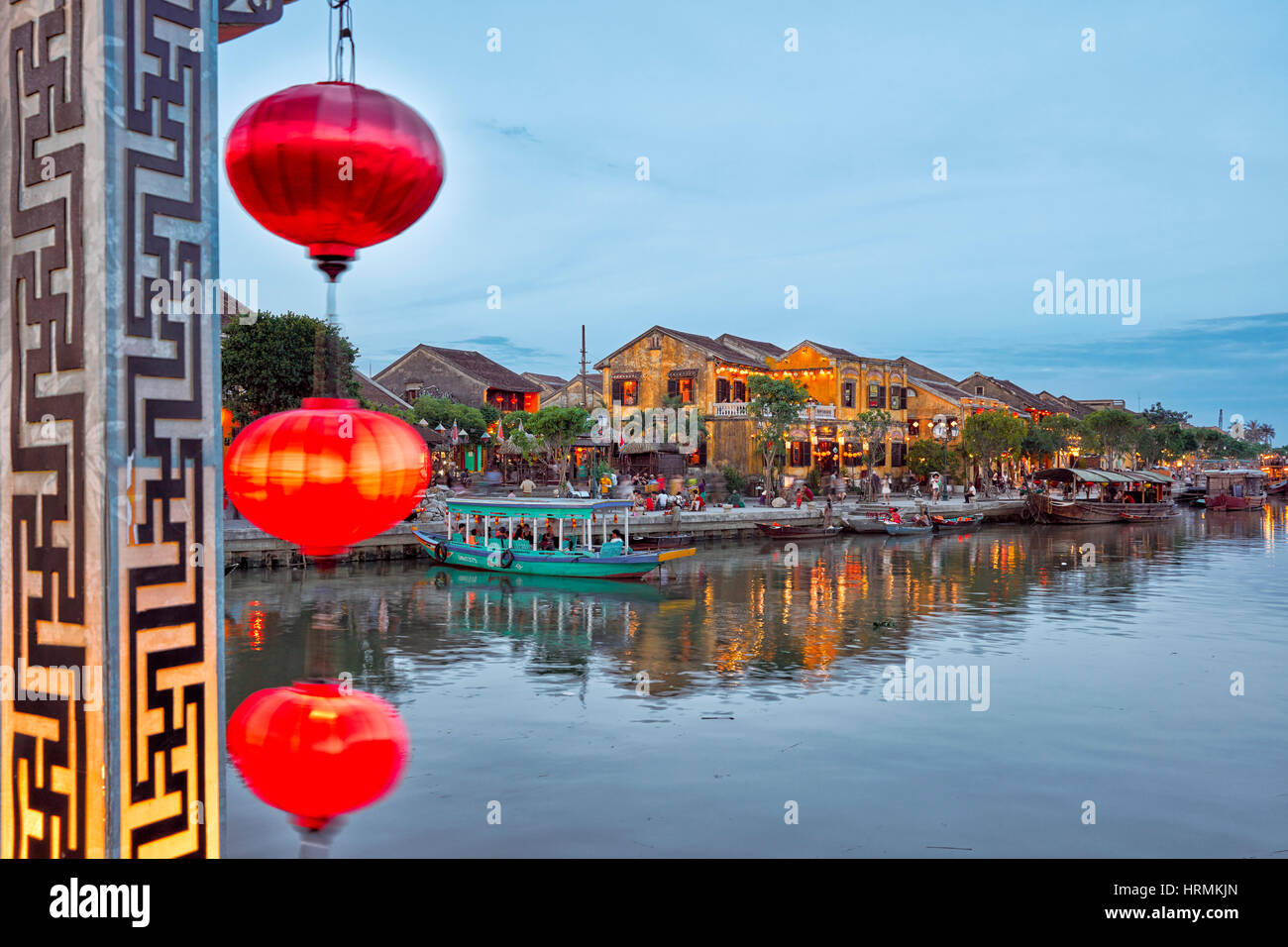 Red lanterns on Cau An Hoi Bridge and view of Hoi An Ancient Town at dusk. Hoi An, Quang Nam Province, Vietnam. - Stock Image