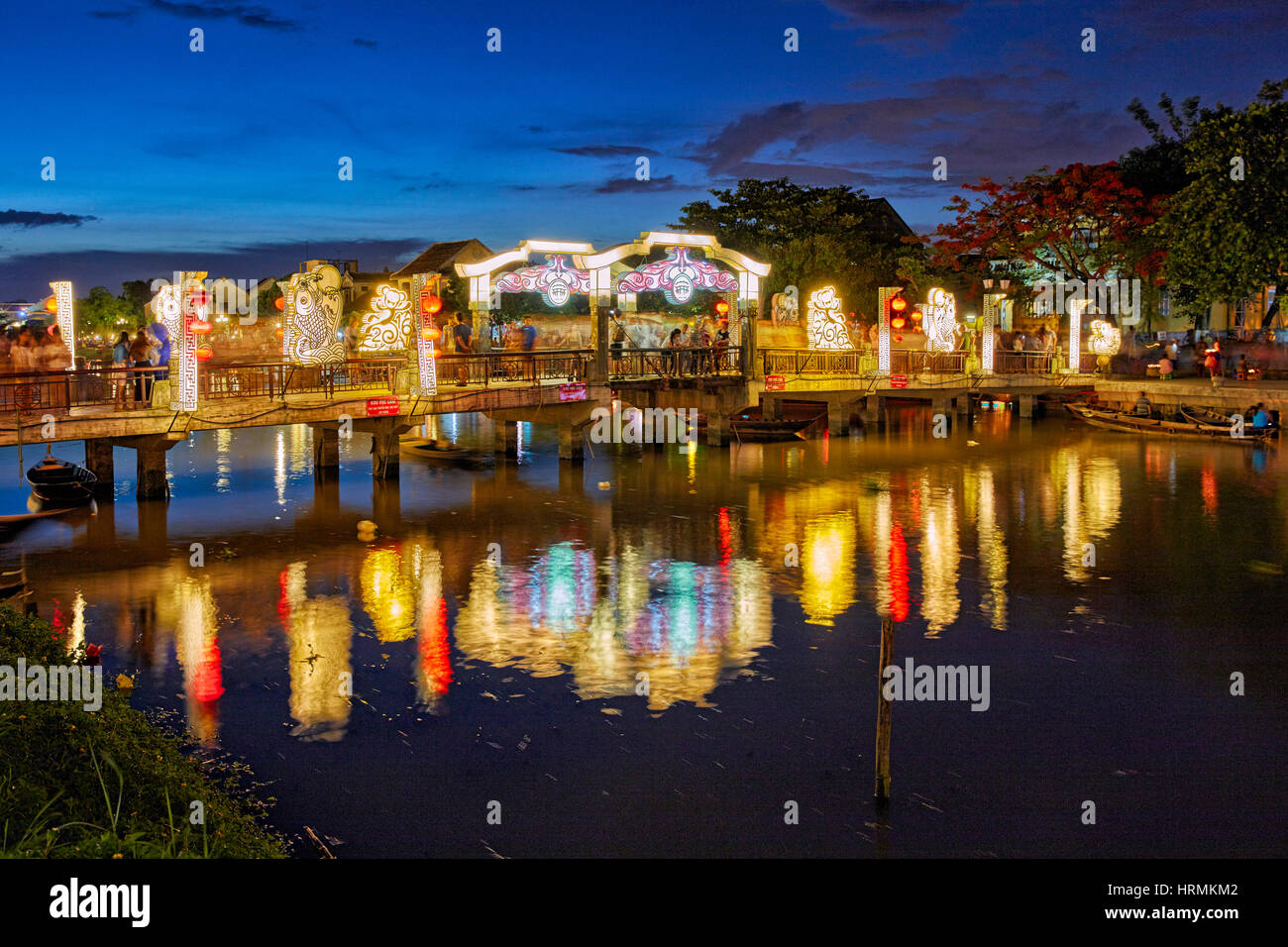 Cau An Hoi Bridge illuminated at dusk. Hoi An Ancient Town, Quang Nam Province, Vietnam. - Stock Image