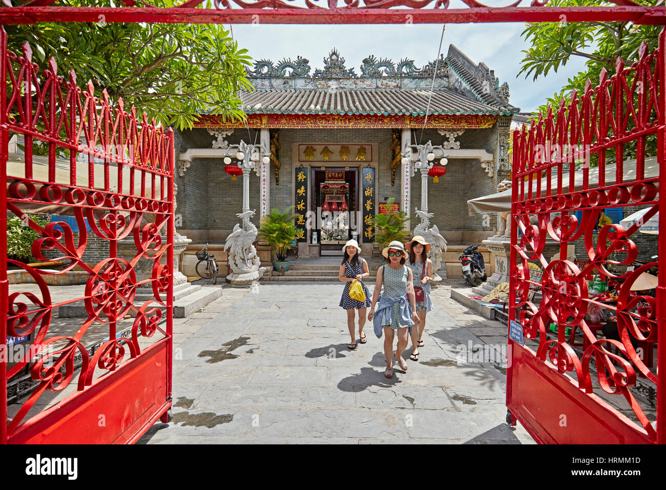 Tourists visiting Cantonese (Quang Trieu) Assembly Hall. Hoi An Ancient Town, Quang Nam Province, Vietnam. - Stock Image
