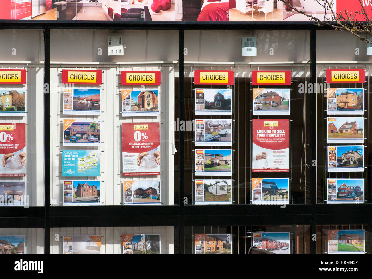 Choices Estates Agents Front Window Display of Property For Sale - Stock Image