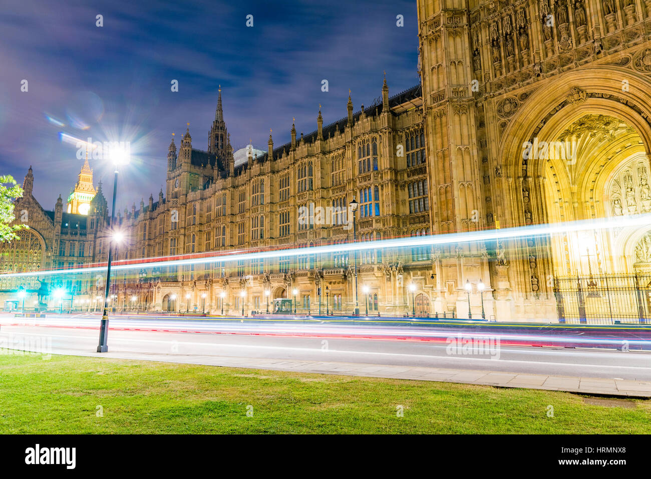 Houses of Parliament at night with ligh trails Stock Photo