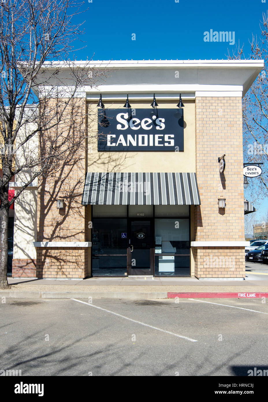 Front of a See's Candies Chocolate Shop store  at the Nut Tree Plaza, Vacaville, California, USA, on a sunday - Stock Image