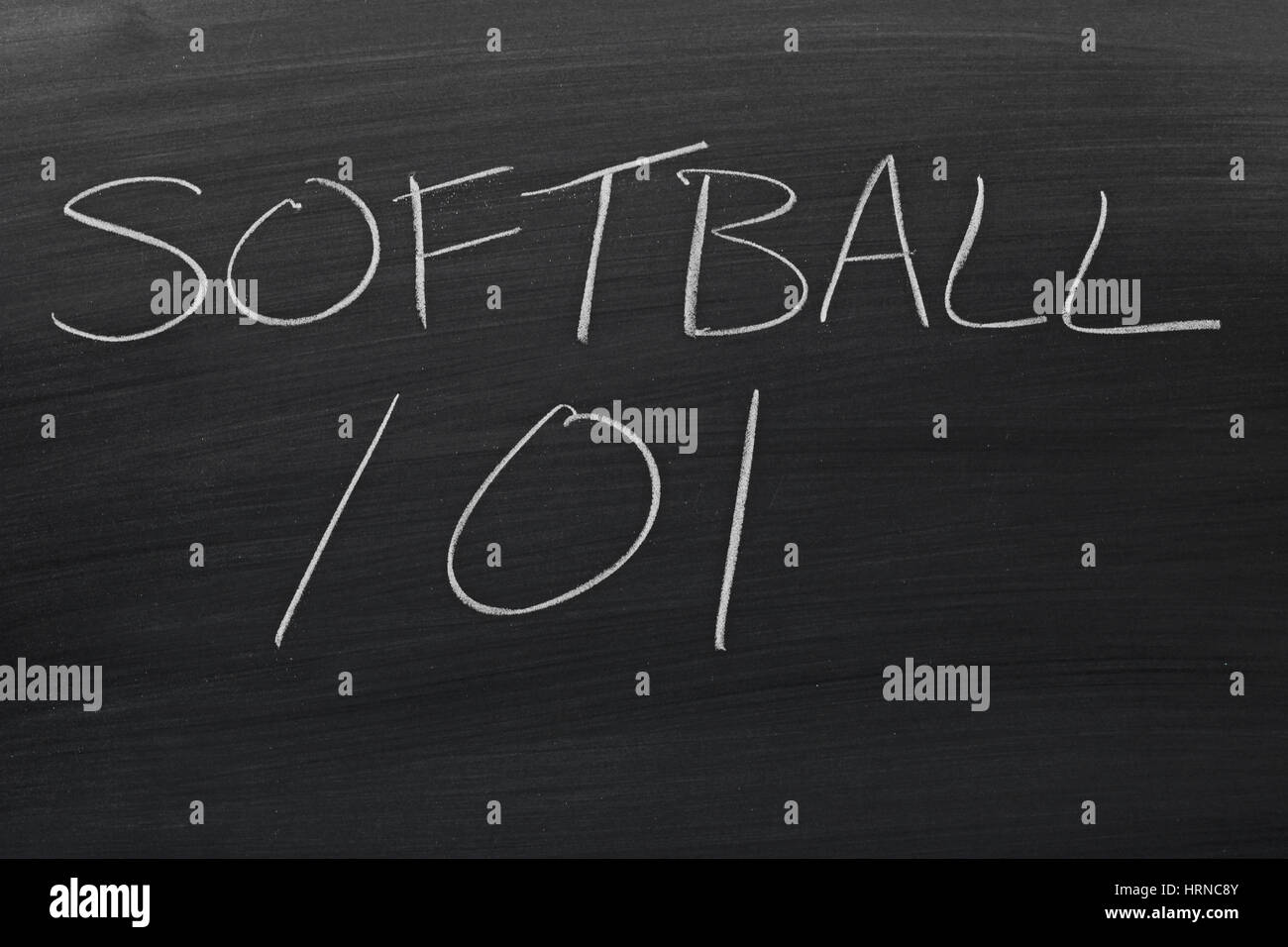 The words 'Softball 101' on a blackboard in chalk - Stock Image
