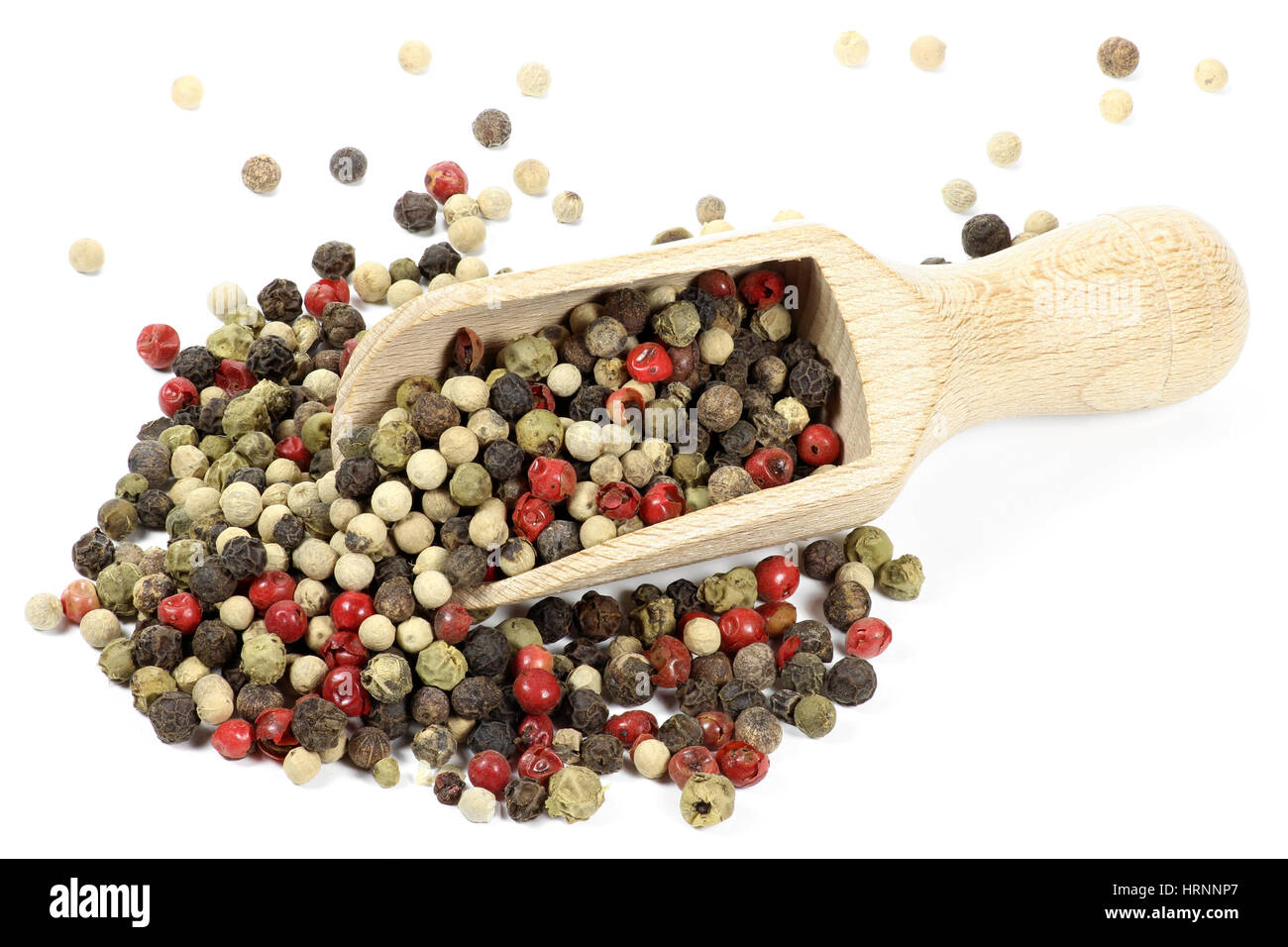 wooden scoop with mixed peppercorns isolated on white background - Stock Image