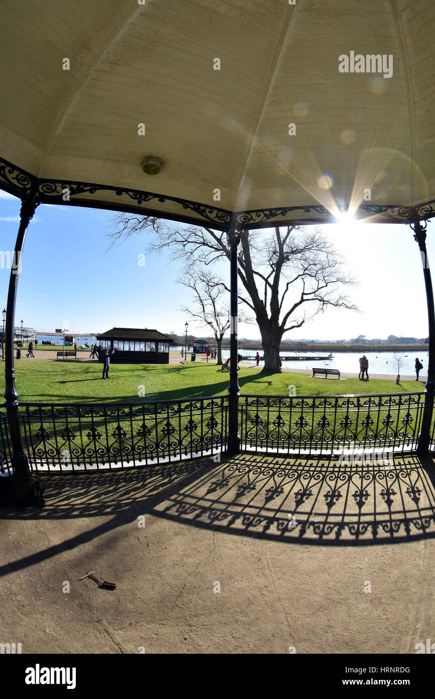 Christchurch harbour, viewed from inside Victorian style bandstand in Dorset, England - Stock Image