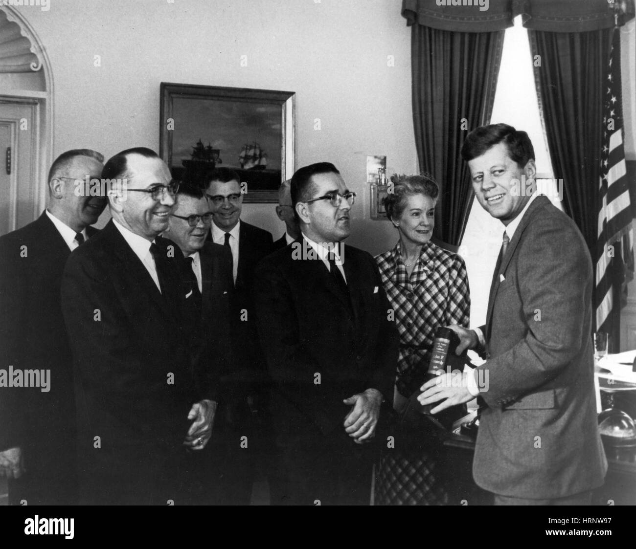 JFK Presented with Public Papers, 1962 - Stock Image