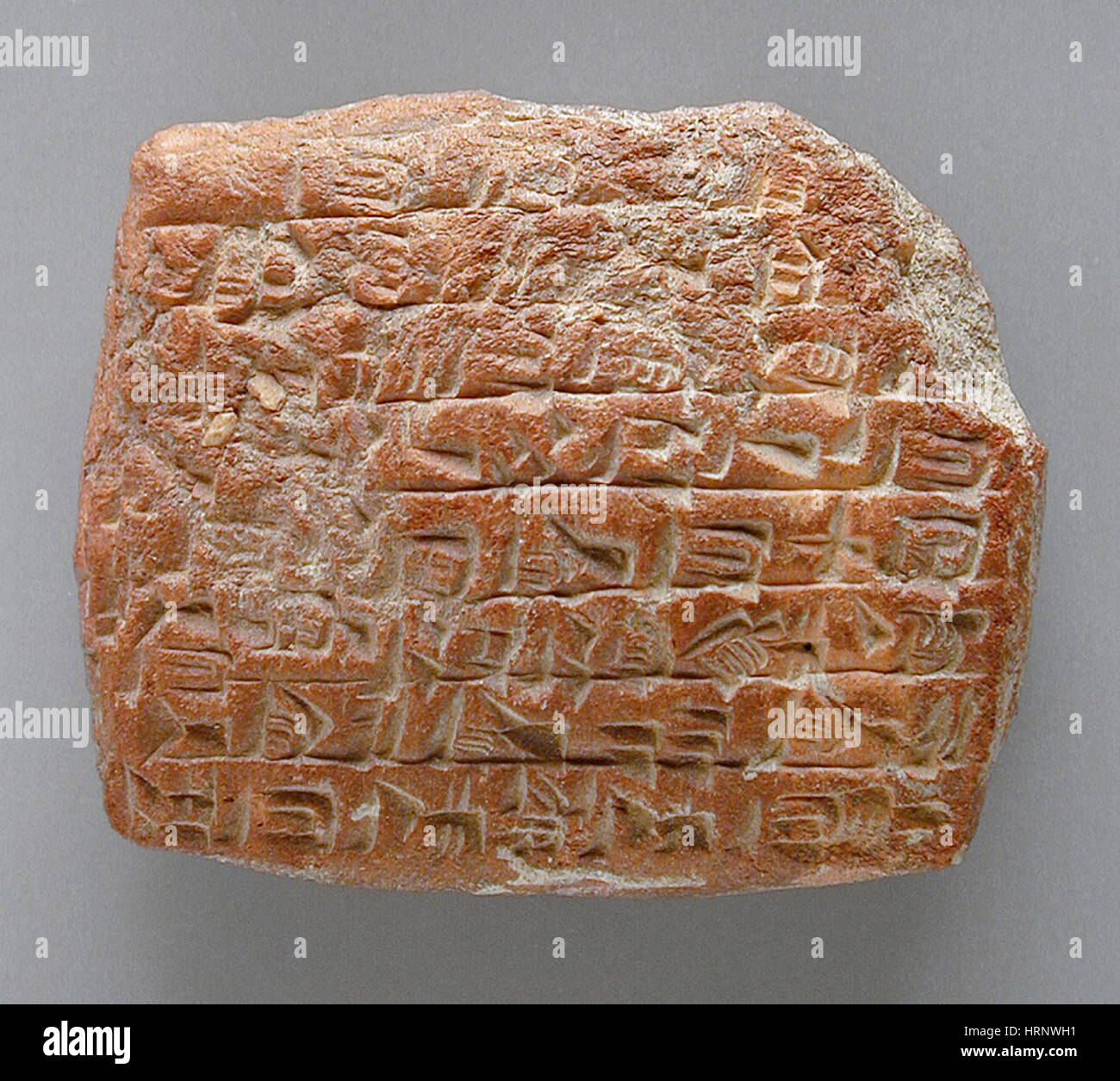 Clay Tablet with Cuneiform Inscription - Stock Image