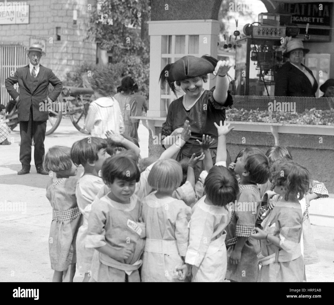 Opera Singer Giving Candy to Children, 1921 - Stock Image
