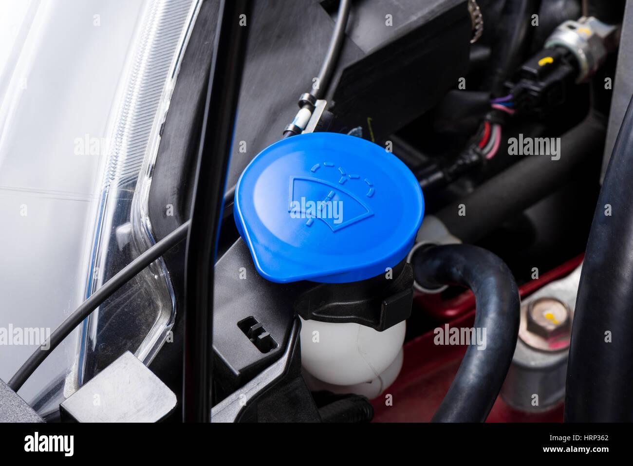 closeup blue windshield washer fluid reservoir cap in engine room Stock Photo: 135095130 - Alamy