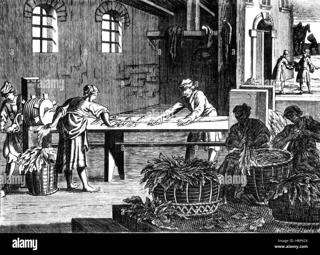 Rolling and Spinning Tobacco, 1722 - Stock Image