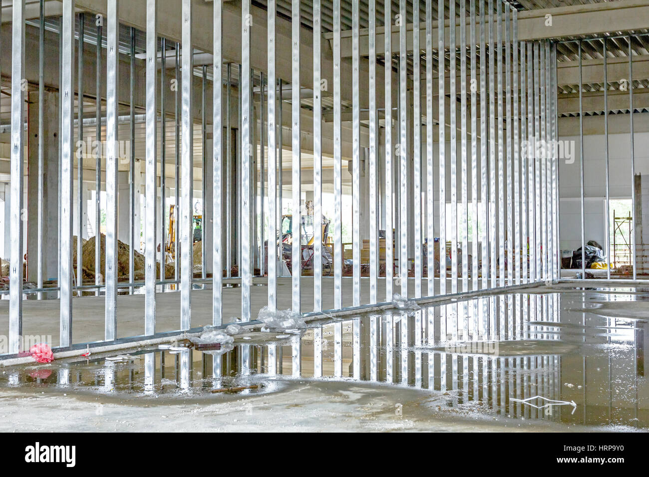 View at unfinished partition wall, plasterboard under construction. - Stock Image