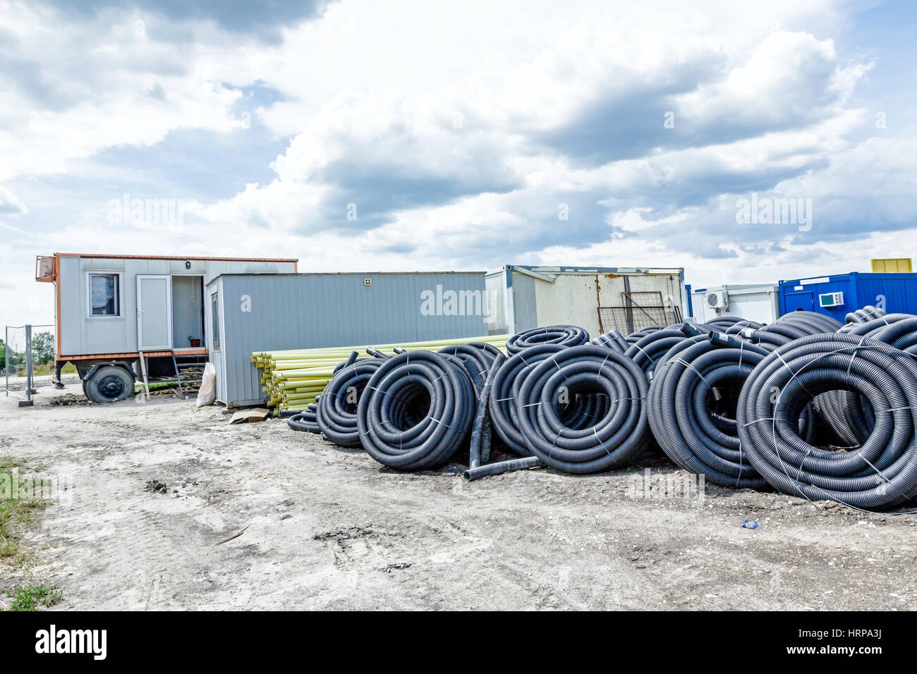 Makeshift storage material, HDPE and PVC pipe for different usage at construction site in the improvised warehouse. - Stock Image