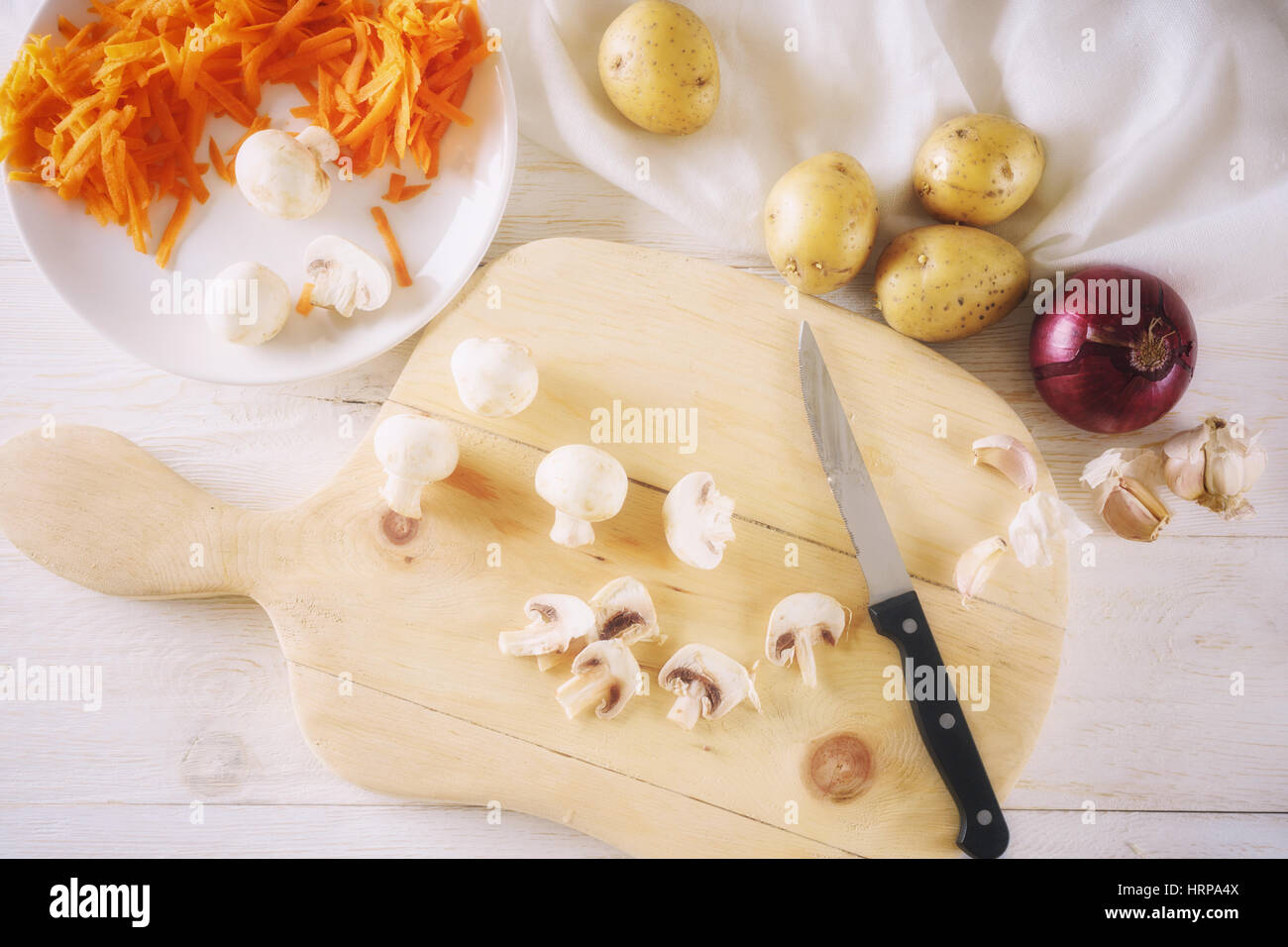 Ingredients for soup, sliced mushrooms. Top view - Stock Image