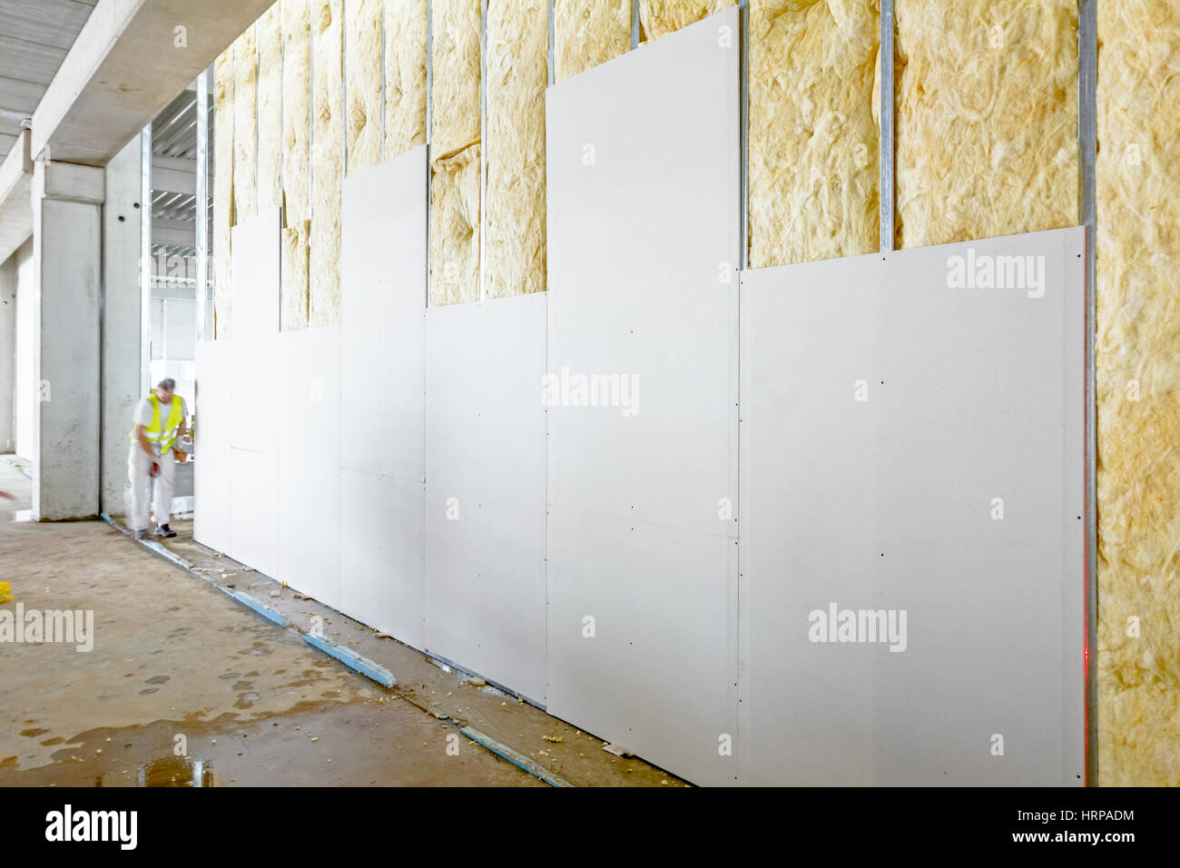 View at unfinished thermal partition dry wall with mineral wool. - Stock Image