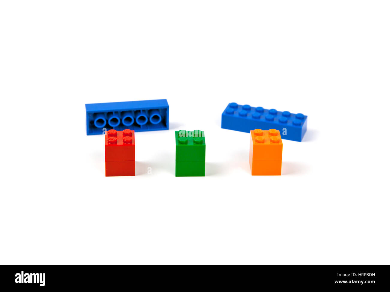 Lego bricks or pieces ready to be mounted on three piers to form a model of a bridge or viaduct. - Stock Image
