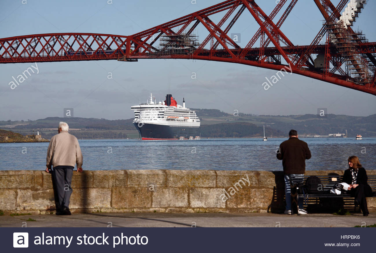 Cruise Liner Queen Mary 2 anchored beneath the Forth Bridge, Scotland - Stock Image