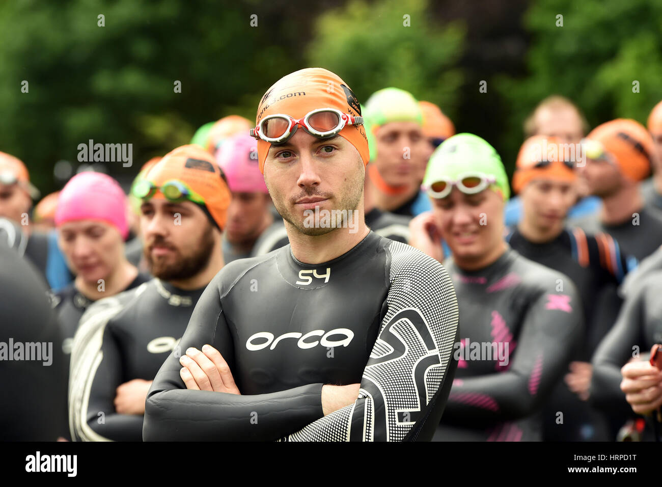Swimmers gather for a briefing before starting the Ullswater Open Water race - Stock Image