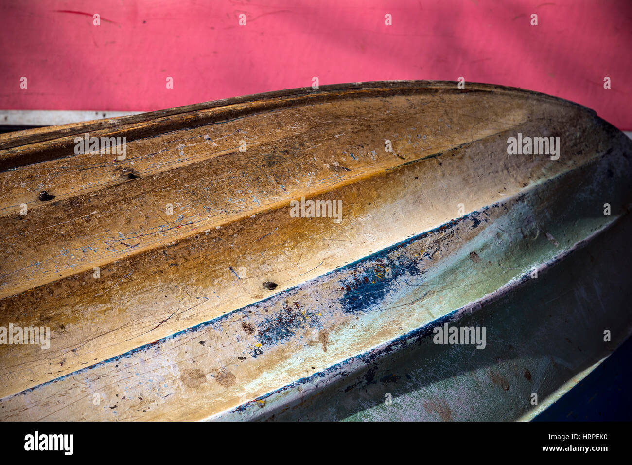 Row boat upturned at  the Devon village of Stoke Gabriel South Hams Devon,multi coloured hull, - Stock Image
