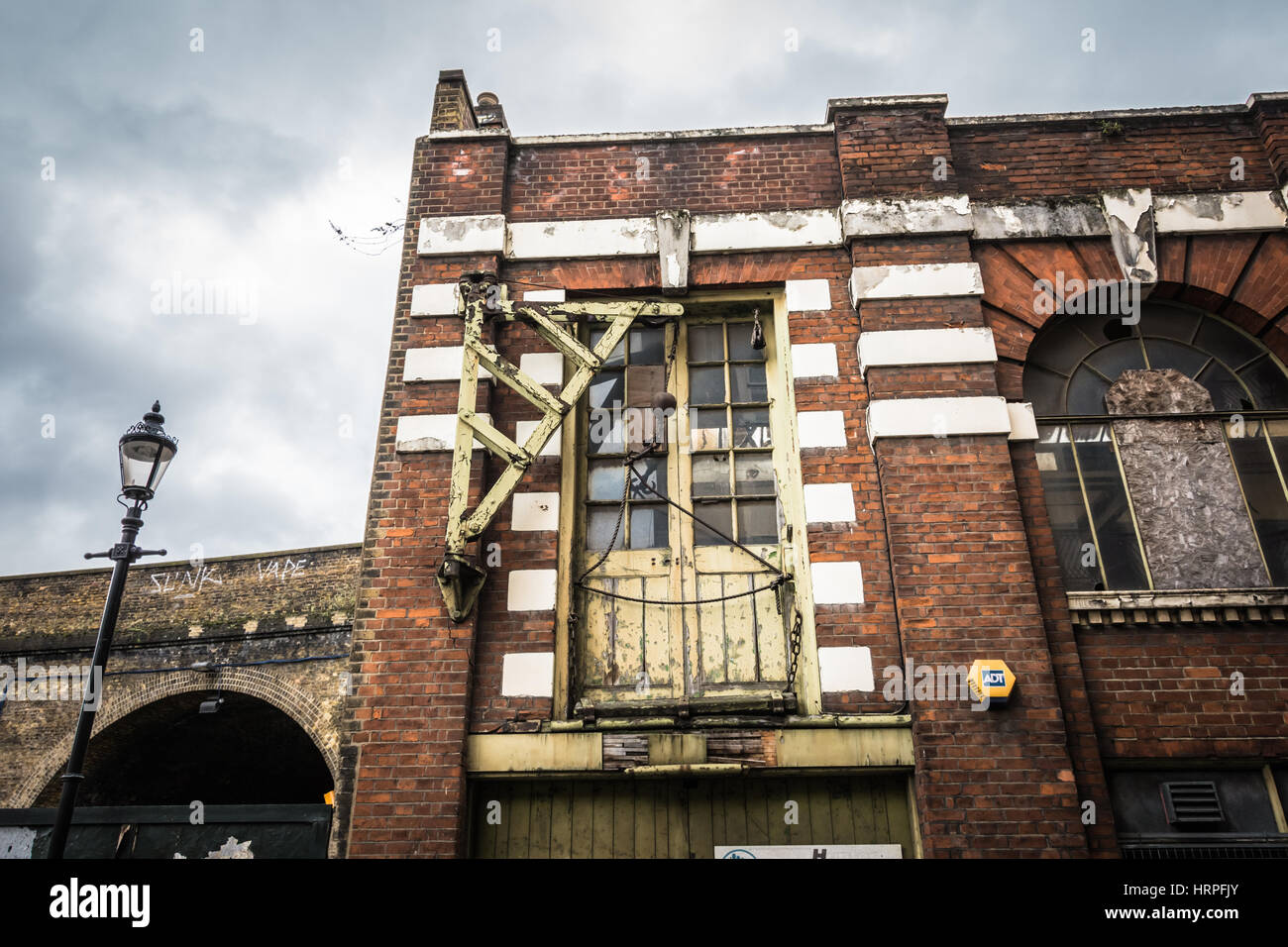 An old industrial pulley and hoist on Red Cross Way, Southwark, London, SE1, UK - Stock Image