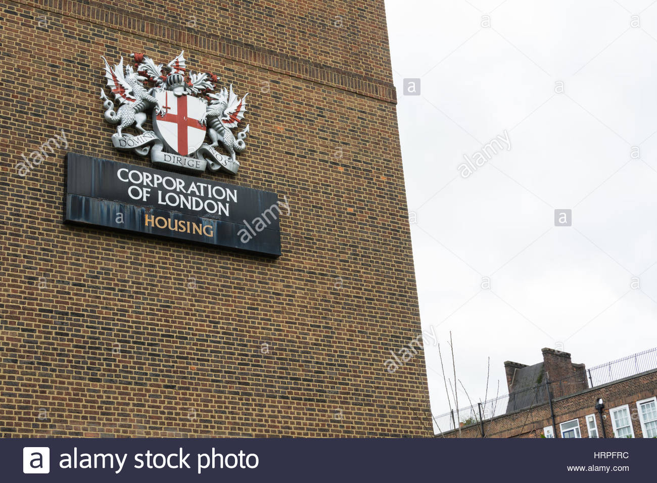 The Corporation of London Coat of Arms on the side of a building in Southwark, London, UK - Stock Image