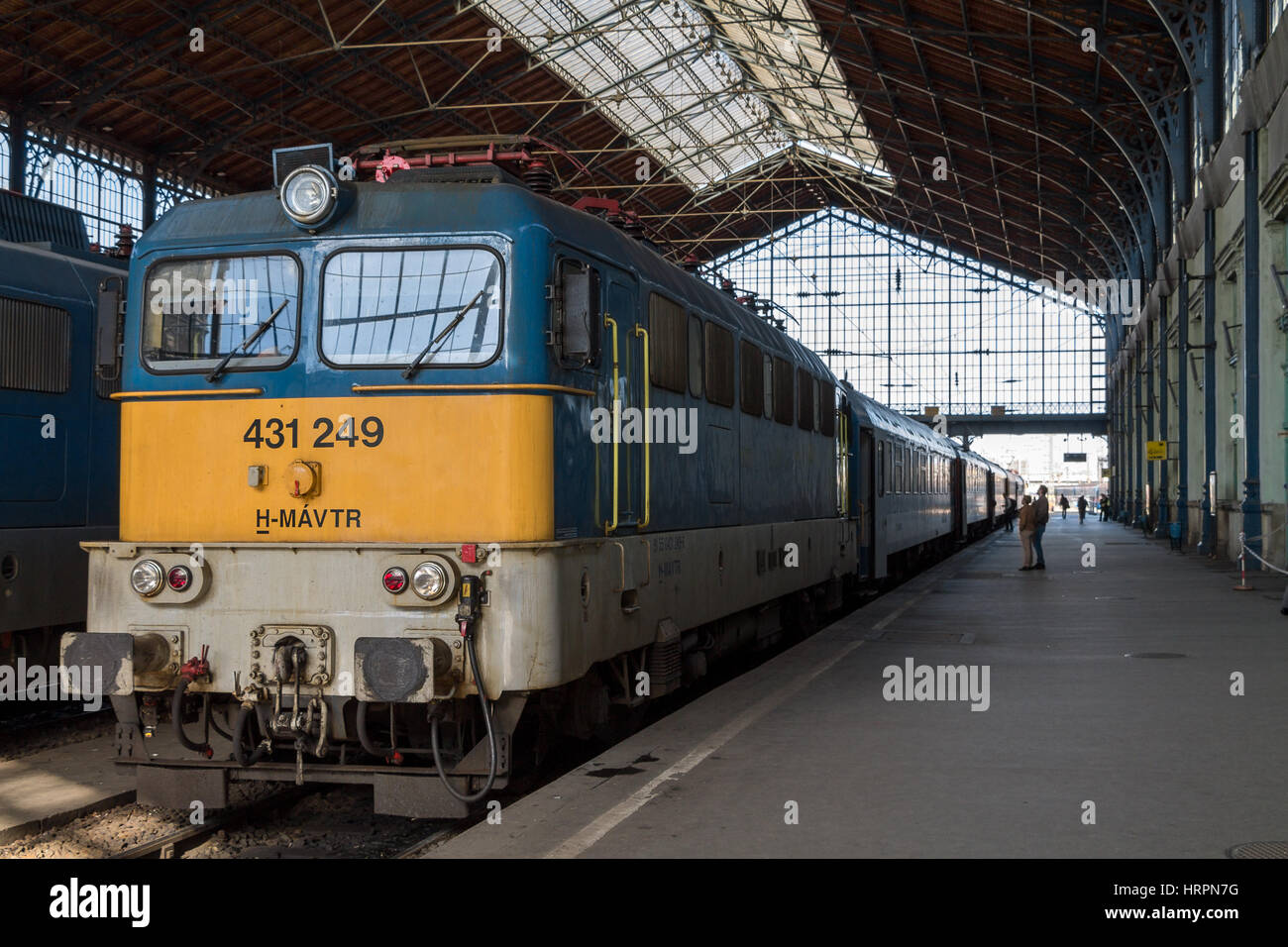 A passenger train in the Nyugati Railway Station in Budapest, Hungary - Stock Image
