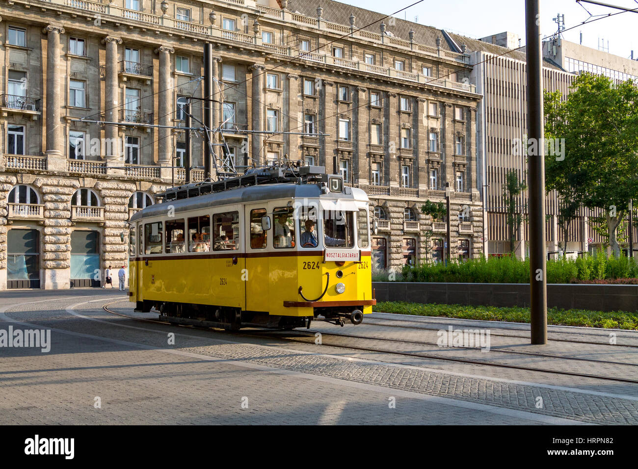 An old tram coming around a corner in Budapest, Hungary Stock Photo