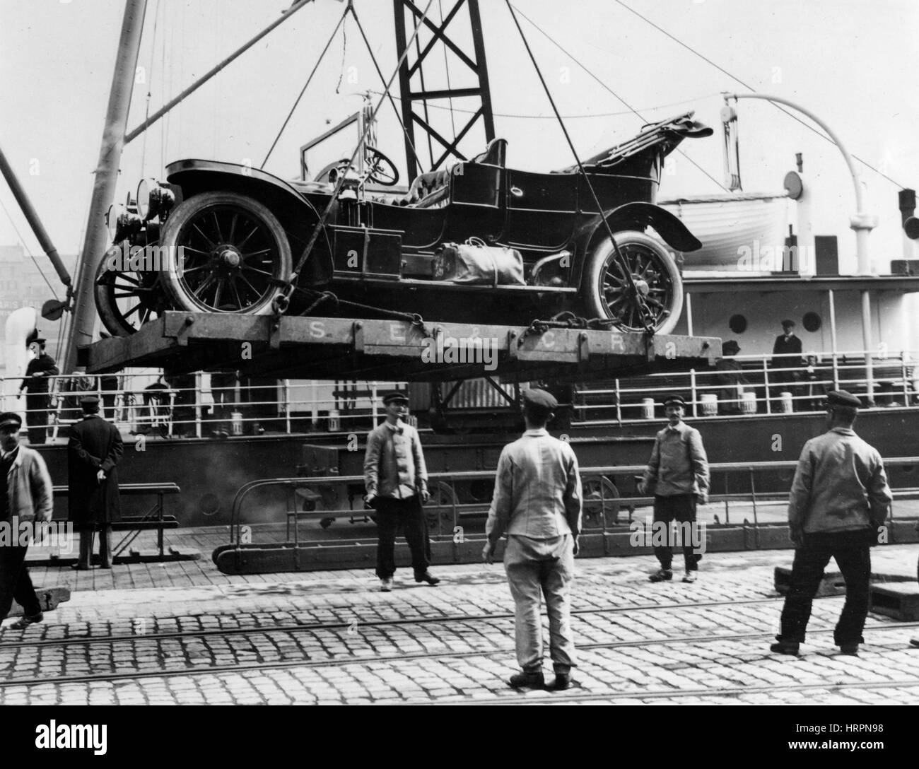 Car being loaded on to ship at Boulogne 1909 - Stock Image
