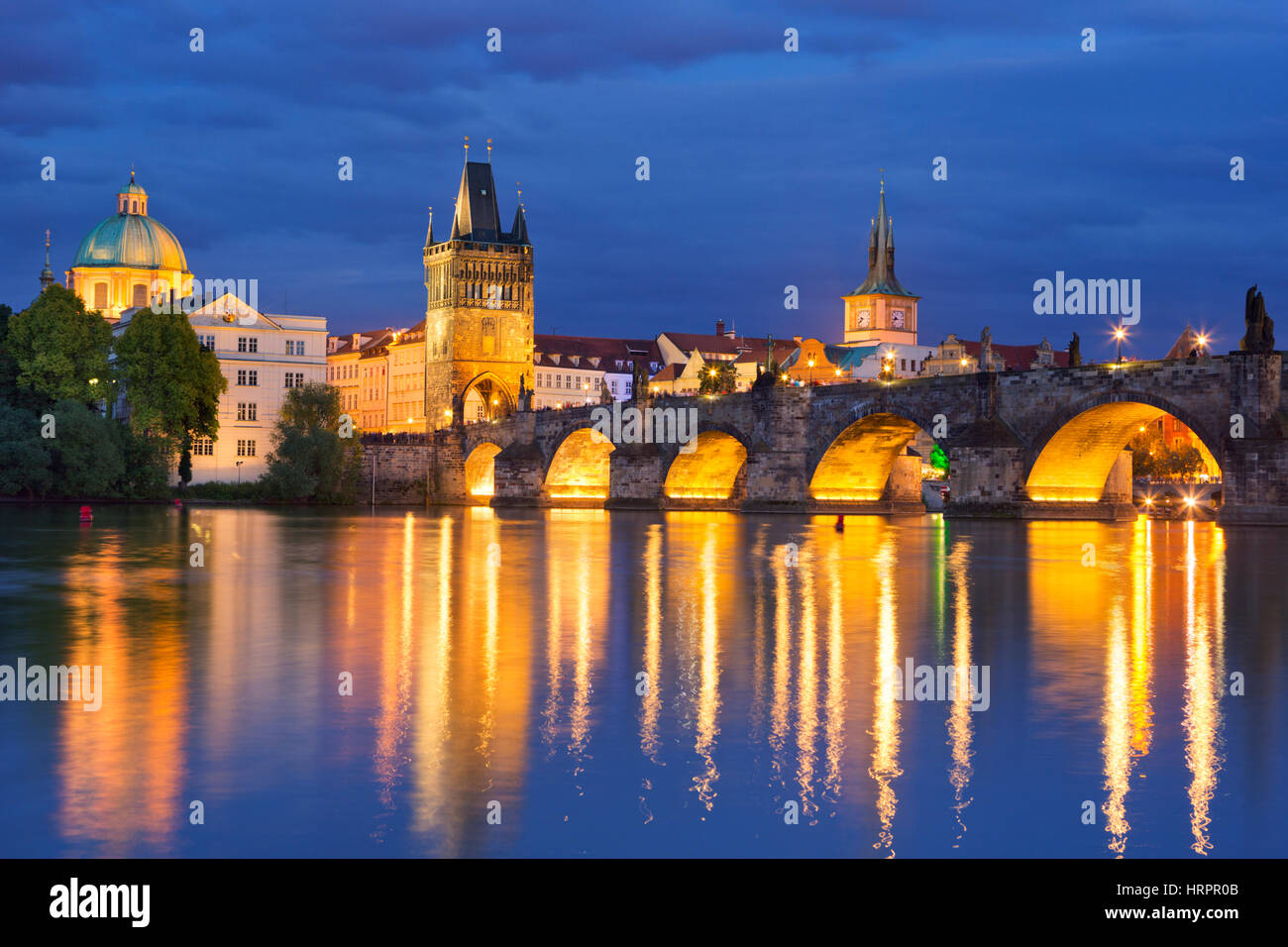 The Charles Bridge over the Vltava River in Prague, Czech Republic, photographed at night. - Stock Image